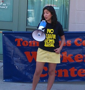 Jessica Perez, Senior Cornell Student in Psychology and Latin American Studies, speaks to a rally of over 50 people in front of Tompkins County Hearings on Living Wages: all very appropriate considering it was International Workers Day!
