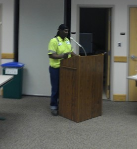 Milton Webb, a worker in the Tompkins County Solid Waste Division, but employed by subcontractor, ReCommunity Recycling, testifying before the County Living Wage Working Group. Webb, and Stanley McPherson, both make $9.00/hour employed by ReCommunity, which is significantly lower than the Living Wage in Tompkins County.