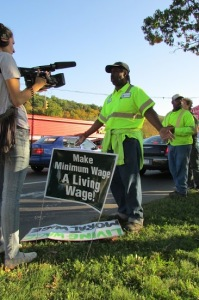 Milton Webb in foreground and Stanley McPherson in the background, along with the Tompkins County Workers' Center, outside ReCommunity Recyling in mid-October 2013 advocating for a Living Wage for all County-contracted workers, in general, and workers at the County's recycling facility, in particular.