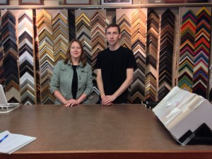 The Frame Shop owner, Emily Russell, on left, with employee, Will King, on right.